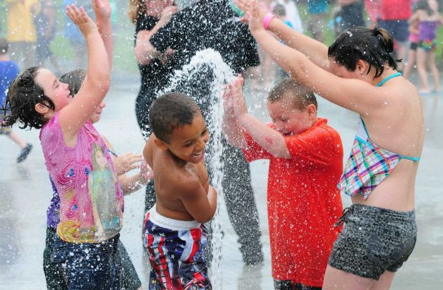 Children play in the water park John Kutey built with his lottery money. Courtesy of Times Union.