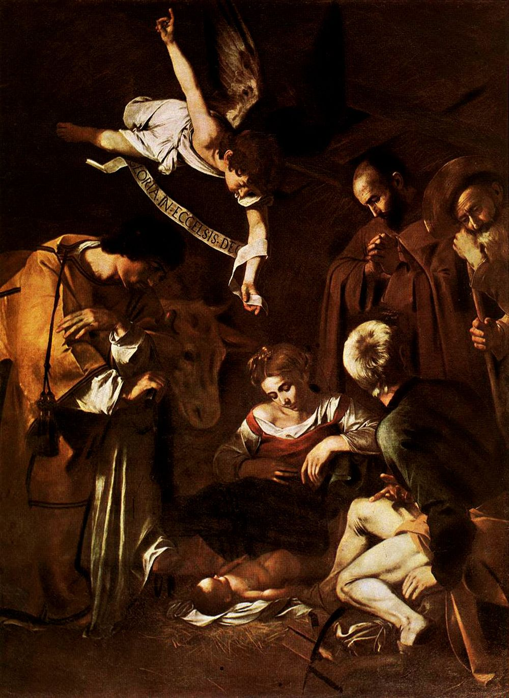 michelangelo_caravaggio_77_nativity_with_st_francis_and_st_lawrence
