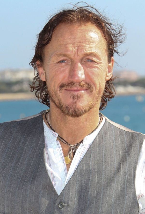 The 55-year old son of father Eric Flynn  and mother Fern Flynn, 183 cm tall Jerome Flynn in 2018 photo